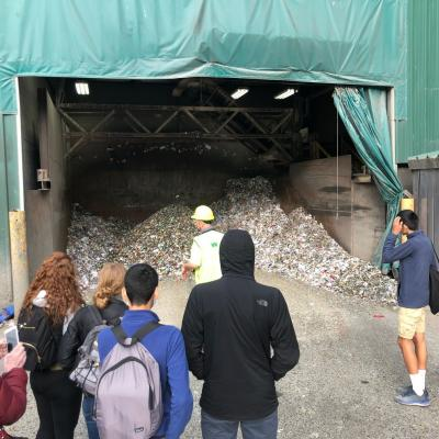Students learning about waste management at the dump.